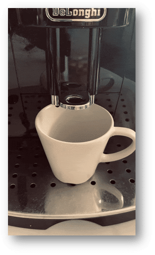 A picture containing cup, coffee, indoor, coffee maker Description automatically generated